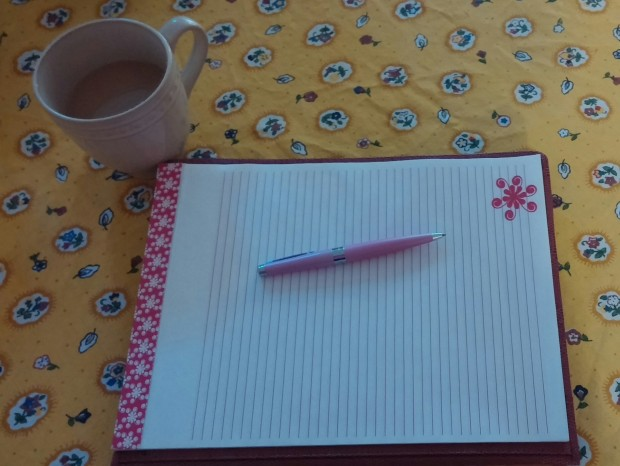 A cup of joe, my favorite pen, a pretty pad of paper